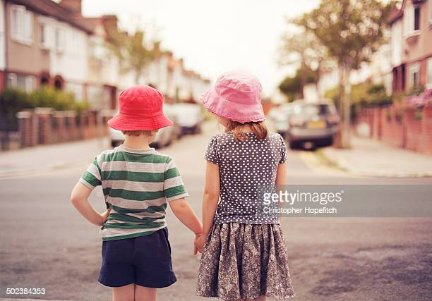 Young friends off for a suburban walk
