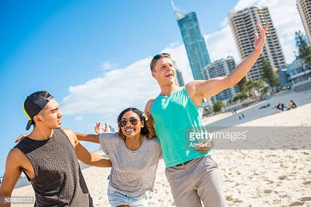 Young friends on beach having fun