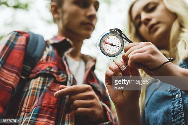 Young friends out on a hike looking at compass