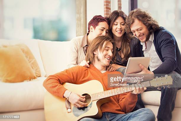 young friends play the guitar and sing
