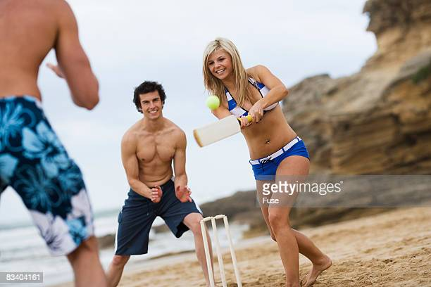 young friends playing cricket - beach cricket stock pictures, royalty-free photos & images