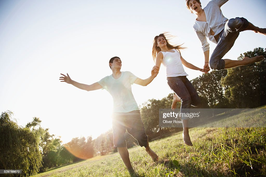Young friends playing in a park : Stock Photo