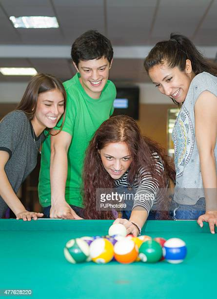 Young friends playing pool or billiard