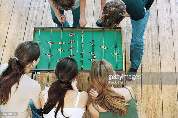Young friends playing table football, overhead view