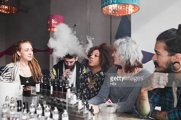 young friends smoking - vaping stock photos and pictures