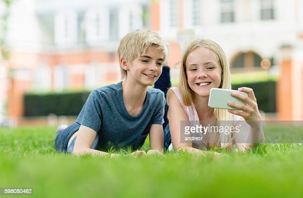 young friends taking a selfie at the park - nice girls pic stock photos and pictures