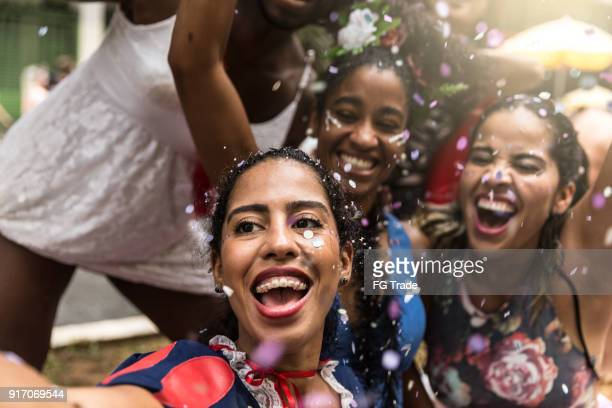 young friends taking selfies and having fun at the carnival street - brazilian carnival stock pictures, royalty-free photos & images