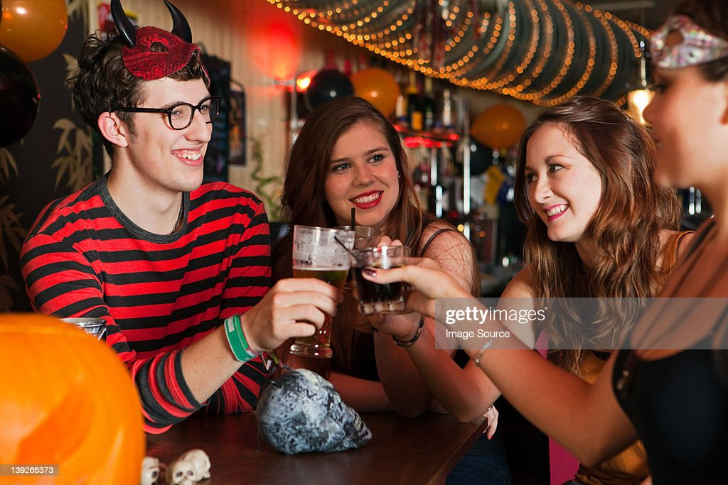 Young friends toasting drinks in bar : Stock Photo