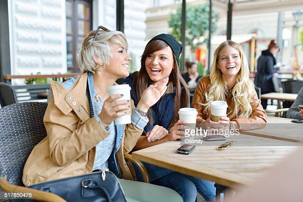 Young friends together drinking coffee in the city