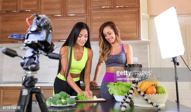 young friends vlogger recording a healthy eating video for theirs vlog - influencer stock pictures, royalty-free photos & images