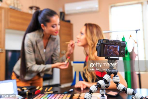 Young friends vlogger recording a makeup video for theirs vlog