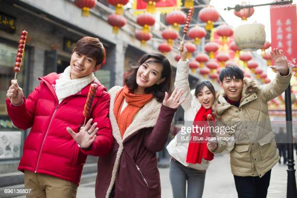 Young friends with candied haw berries celebrating Chinese New Year