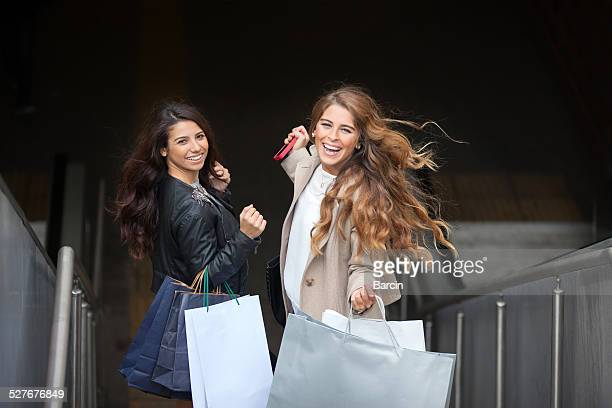 Young friends with shopping bags