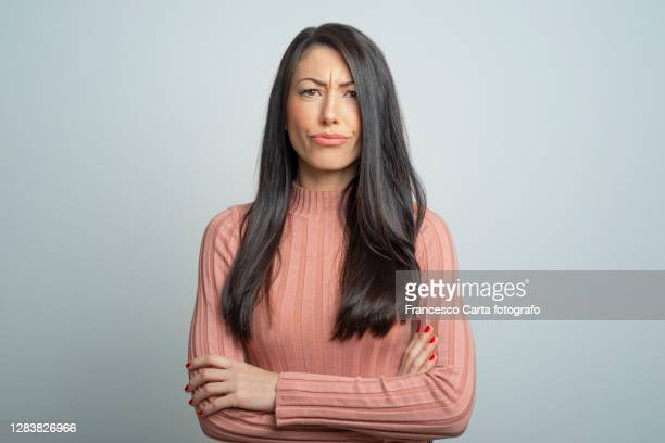 young frowning lady - uncertainty stock pictures, royalty-free photos & images