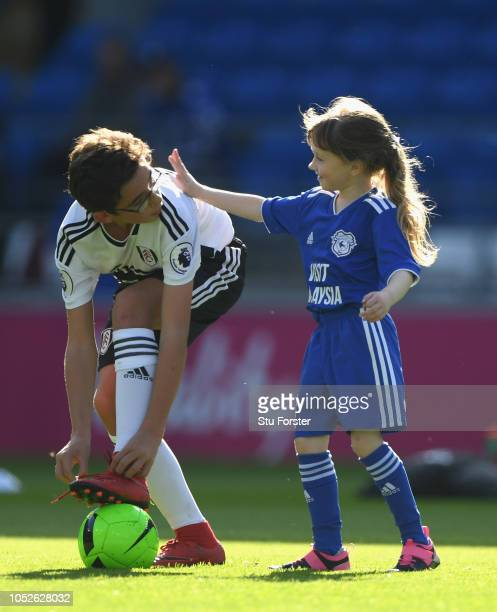 Young Fulham and Cardiff mascots play during the Premier League match between Cardiff City and Fulham FC at Cardiff City Stadium on October 20 2018...