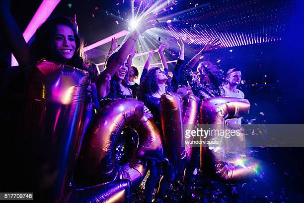 Young fun loving friends celebrating party in a club