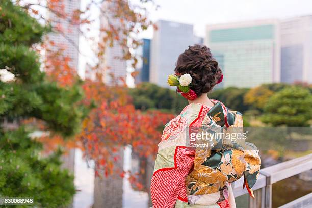 young furisode girl in autumn garden - seijin no hi stock pictures, royalty-free photos & images