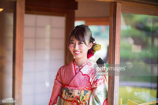 Young Furisode girl walking in Japanese house