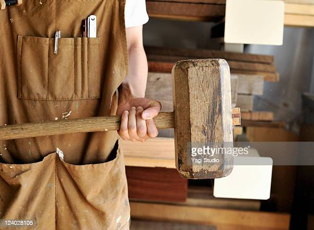 young furniture craftsman have a mallet. - mallet hand tool stock pictures, royalty-free photos & images