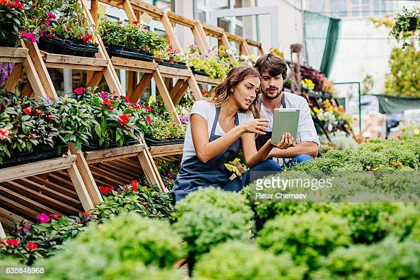 Young gardeners with digital tablet