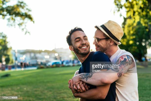 young gay couple showing emotions - coppia omosessuale foto e immagini stock