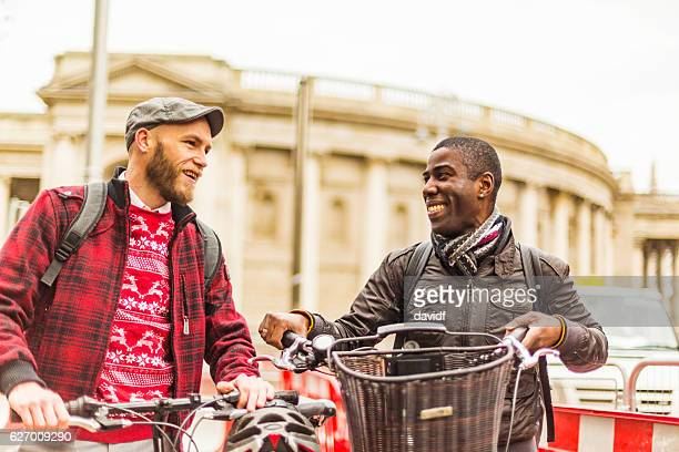 Young Gay Men Tourist Couple at Irish Parliament With Bicycles
