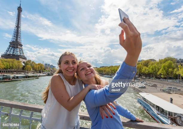 Young Gay Women Couple Taking Selfie Self Portraits with the Eiffel Tower