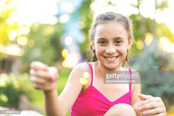Young Generation Z Female Playing with Sparklers During the Summer Holiday Season
