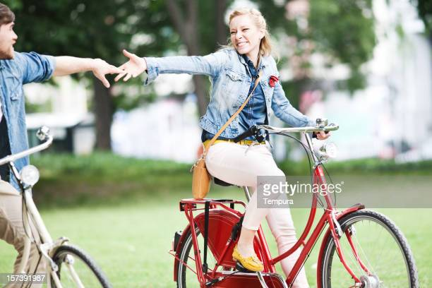Young german couple riding a bicycle in Berlin.