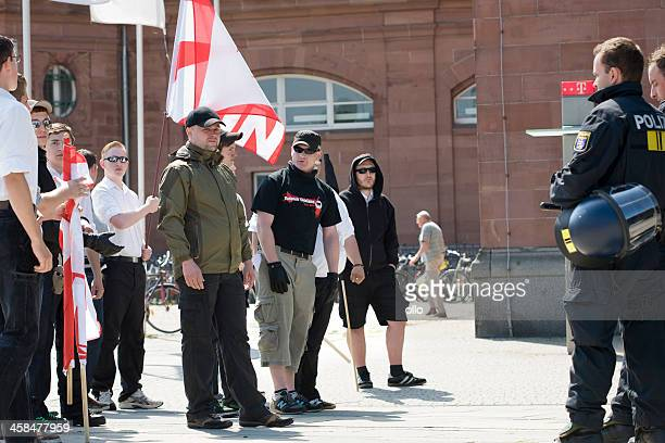 young german neonazis against riot police - nazism stock pictures, royalty-free photos & images
