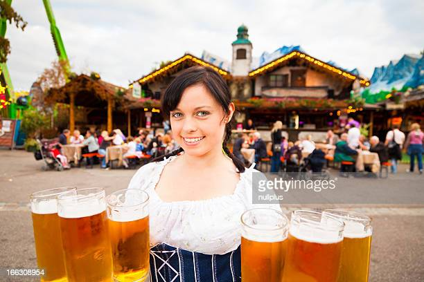 young german woman serving beer