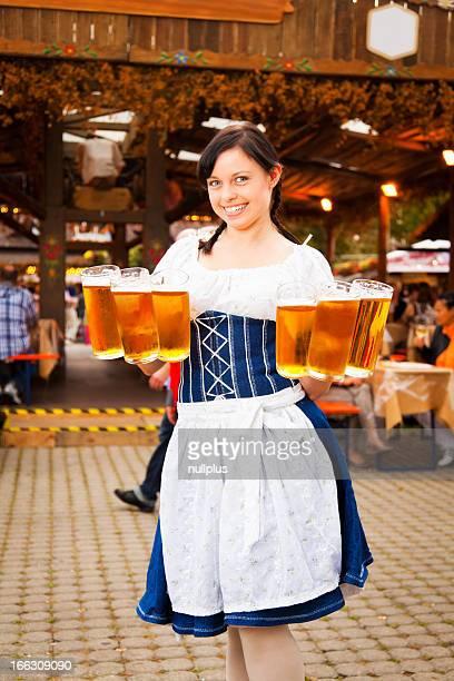 young german woman serving beer