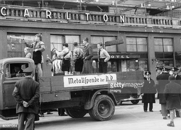 Young Germans collecting metal in the streets of Bratislava on the occasion of Hitlers birthday Photograph Around 1940 [Die Deutsche Jugend sammelt...
