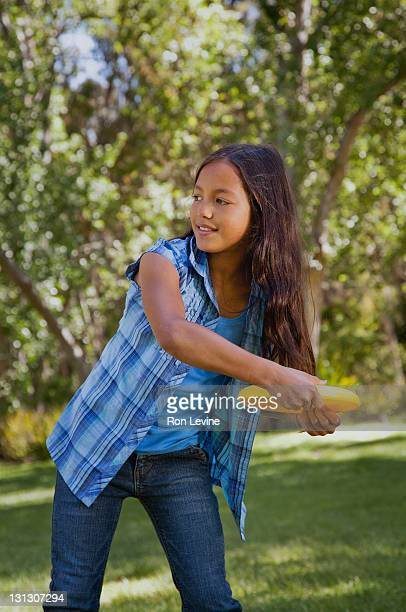 Young girl about to throw a frisbee disk