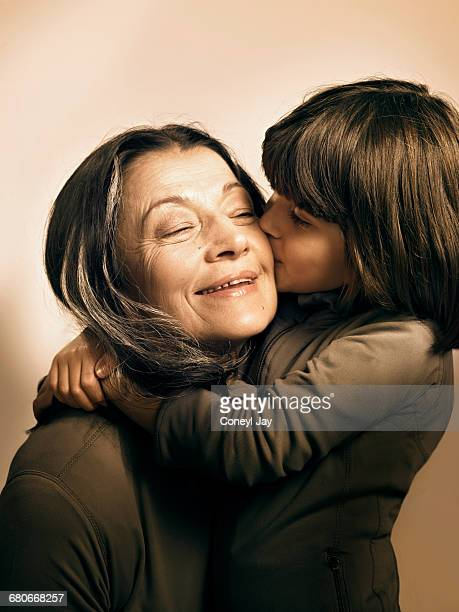 Young girl affectionately hugs older woman