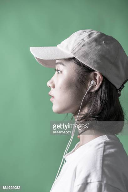 young girl against green background in studio
