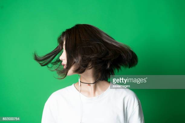 young girl against green background in studio - ショートヘア ストックフォトと画像