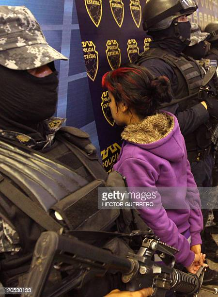 A young girl alleged member of Los Zetas cartel drugs is presented to the press by Police in Guadalajara Jalisco State on August 6 2011 The girl was...