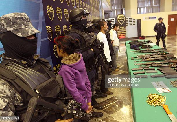 """Young girl alleged member of """"Los Zetas"""" cartel drugs is presented to the press by Police in Guadalajara, Jalisco State, on August 6, 2011. The girl..."""