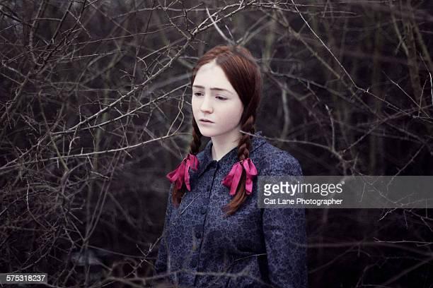 Young girl amongst thorns