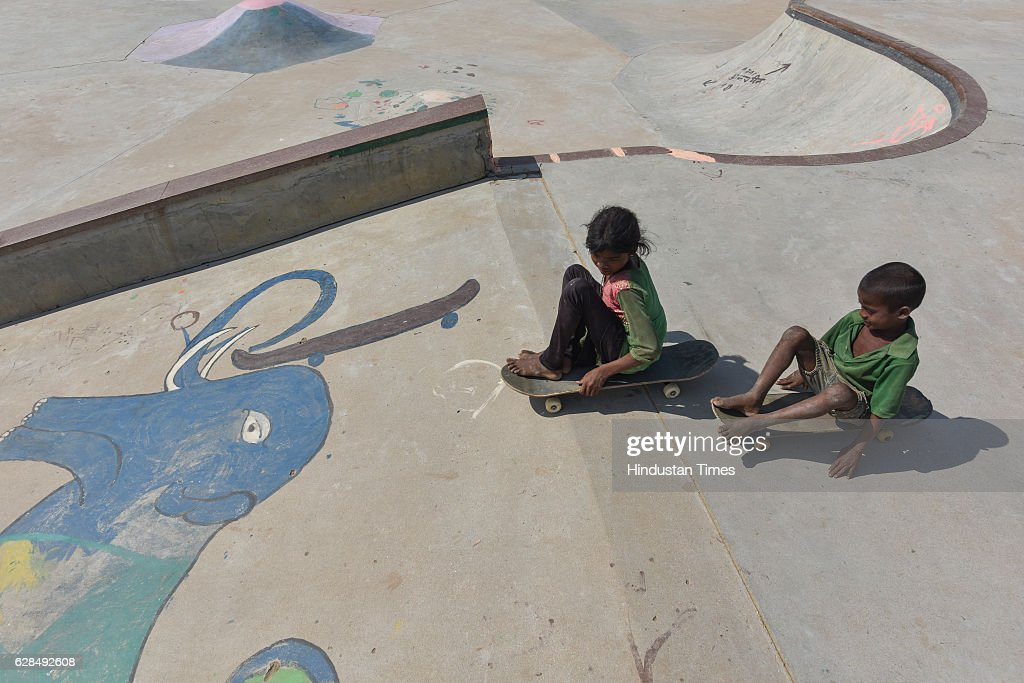 A young girl and a boy roll on their skateboards at Skating Park, popularly known as Janwaar Castle, on October 26, 2016 in Janwaar, India. Thanks to a German community activist and author Ulrike Reinhard, skateboarding is slowly changing the children in this Madhya Pradesh village divided by caste. Located along the fringes of the Panna National Tiger Reserve, the Janwaar Skating Park is a not-for-profit project that teaches village children skateboarding free of cost. The park is a place for unfettered fun, but has two strict ground rules. Rule number one: Girls first. And rule number two: No school, no skateboarding. The park also bridges caste disparities by bringing together the village Adivasi and upper caste Yadav and Kushwaha children to play together.