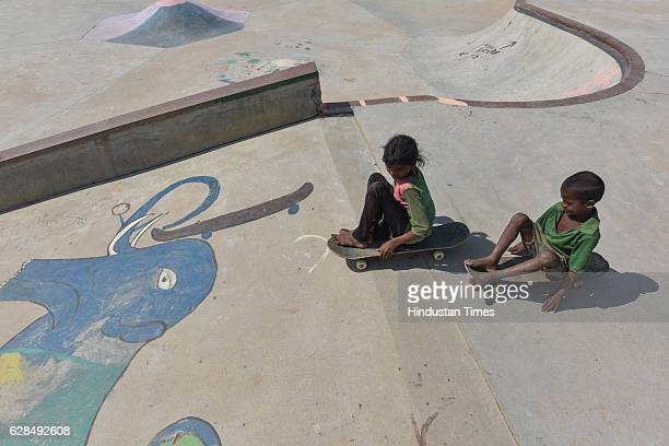 Young girl and a boy roll on their skateboards at Skating Park, popularly known as Janwaar Castle, on October 26, 2016 in Janwaar, India. Thanks to a...