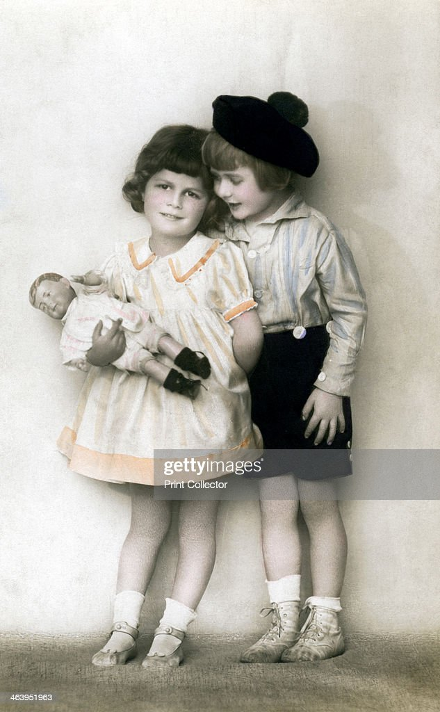 A young girl and boy, early 20th century. : News Photo