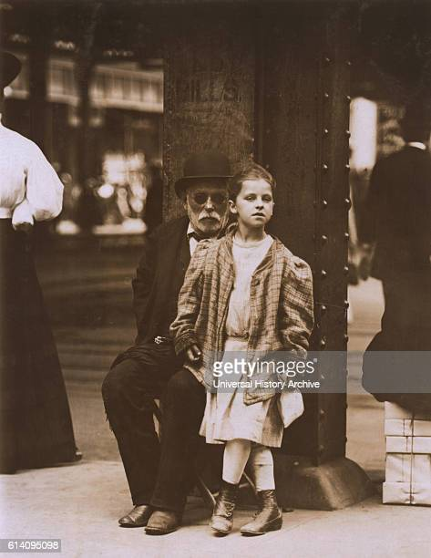 Young Girl and Elderly Man Begging 6th Avenue and 14th Street New York City New York USA circa 1910
