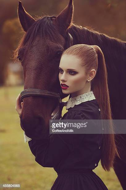 young girl and her beautiful horse - high fashion stock pictures, royalty-free photos & images