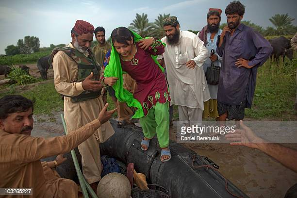 A young girl and her family are rescued by Pakistan Army personnel from rising waters on August 6 2010 in the village of Panu Akil near Sukkur...