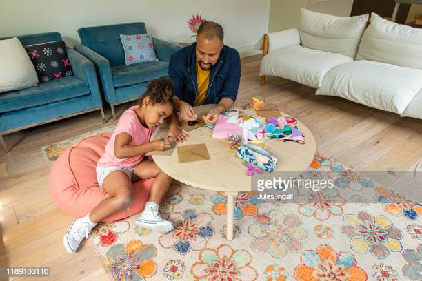 young girl and her father making cards - craft stock pictures, royalty-free photos & images