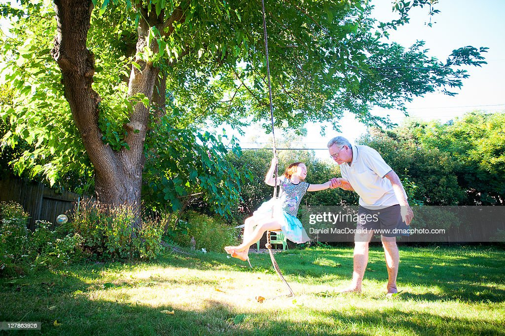 Young girl and her grandpa : Stock Photo