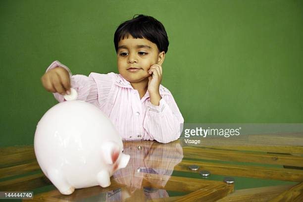 A young girl and her piggybank