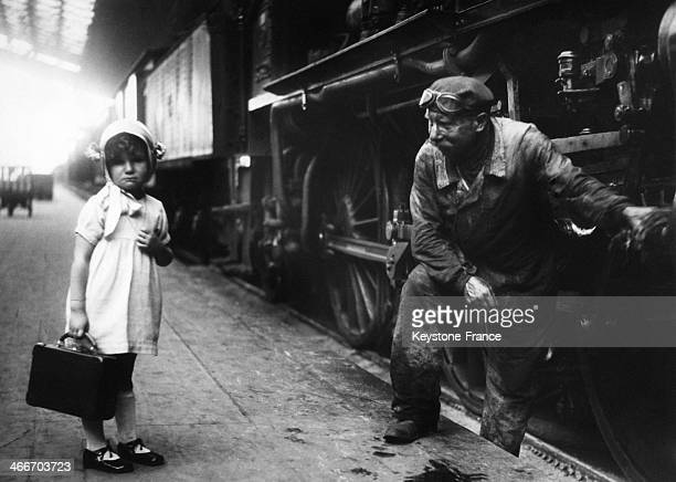 Young girl and locomotive driver in station a few minutes before to start in July 1935 in France